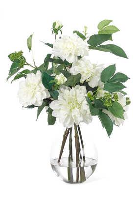 زهور داليا في مزهرية زجاجية دائرية