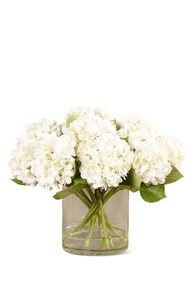 زهور هدرانج صناعية في مزهرية زجاجية